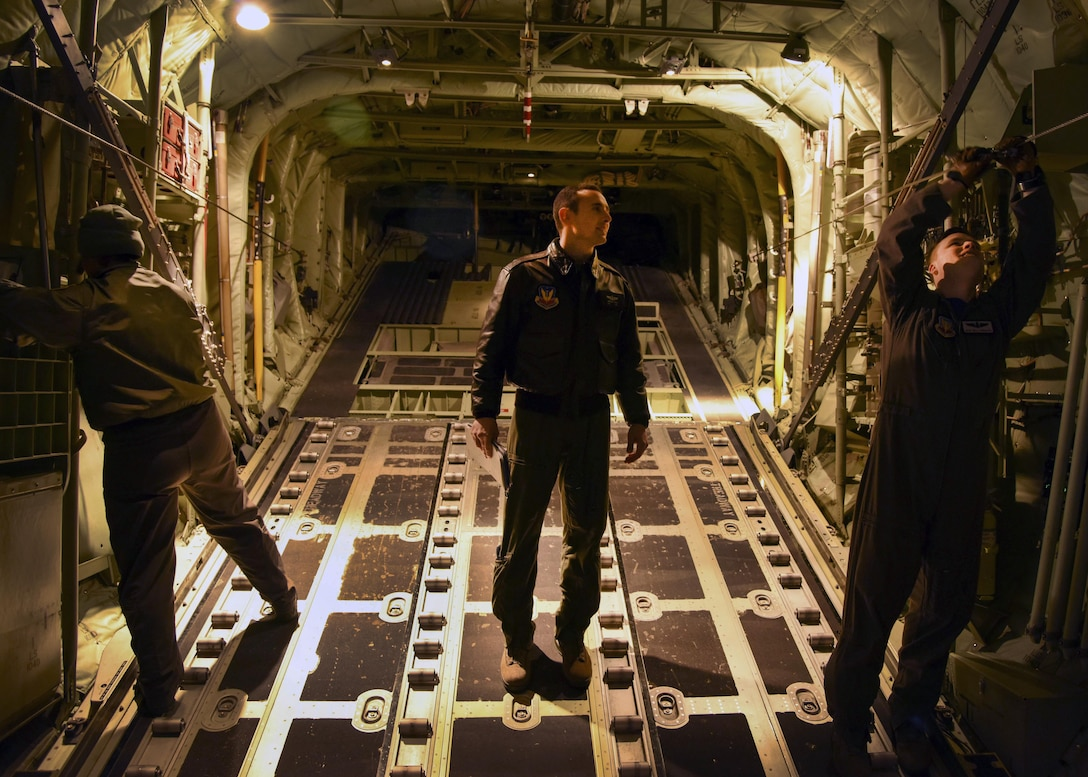 U.S. Air Force Staff Sgt. Jonathan Stager, center, 29th Weapons Squadron instructor loadmaster, supervises U.S. Air Force Master Sgt. Leilani Mclimans, left, 29th WPS instructor loadmaster, and U.S. Air Force Master Sgt. William Freshley, right, 29th WPS instructor loadmaster, as they perform the Airdrop Preparation Checklist Feb. 3, 2017, at Little Rock Air Force Base, Ark. Loadmasters must fly every 45 days to remain certified. (U.S. Air Force photo by Senior Airman Stephanie Serrano)