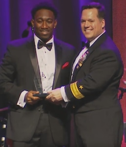"""WASHINGTON (Feb. 11, 2017) - Naval Surface Warfare Center (NSWC) Commander Rear Adm. Tom Druggan presents the Black Engineer of the Year (BEYA) Community Service Award to Dwayne Nelson, NSWC Dahlgren Division engineer, at the 31st annual BEYA gala. """"This award has inspired and challenged me to contribute more towards empowering our youth and others to serve our community while encouraging interest in highly-rewarding science, technology, engineering and mathematics (STEM) fields,"""" said Nelson. """"Giving back and empowering people to reach their full potential is vital to stimulating enthusiasm about STEM. Every step, no matter how large or small, helps strengthen the arduous efforts in sustaining monumental, long-term, positive change within our communities.""""  (U.S. Navy photo/Released)"""