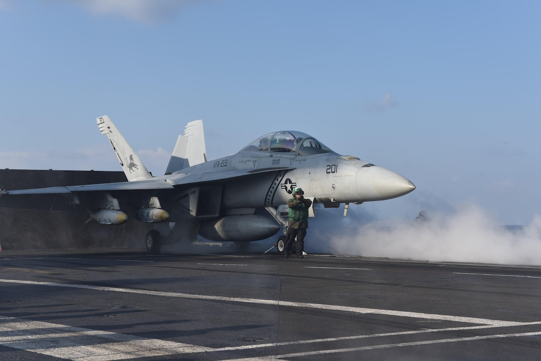 "MEDITERRANEAN SEA (Feb. 13, 2017) An F/A-18F Super Hornet assigned to the ""Black Lions"" of Strike Fighter Squadron (VFA) 213 launches from the aircraft carrier USS George H.W. Bush (CVN 77) in support of Operation Inherent Resolve. The ship's carrier strike group is conducting naval operations in the U.S. 6th Fleet area of operations in support of U.S. national security interests. (U.S. Navy photo by Mass Communication Specialist 3rd Class Christopher Gaines/Released)"