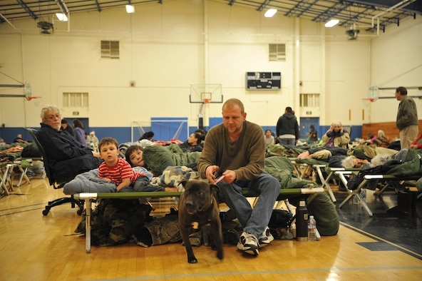 A family gets settled into an emergency shelter following the Oroville spillway evacuation notice at Beale Air Force Base, California, Feb. 13, 2017. Beale provided evacuees with shelter, food, and water. (U.S. Air Force photo/Airman Tristan D. Viglianco)