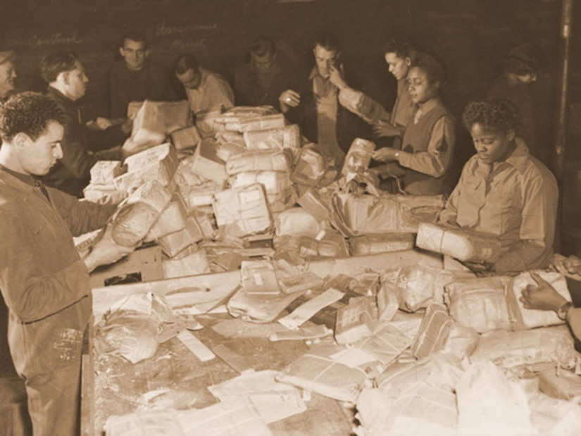 French civilians and soldiers from the 6888th Central Postal Directory Battalion sort mail in France during the spring of 1945. Viewing their jobs as crucial to morale at the front, they processed some 65,000 pieces of mail a shift and worked three shifts a day. At the same time, the soldiers faced constant prejudice and broke gender and racial barriers. Army photo