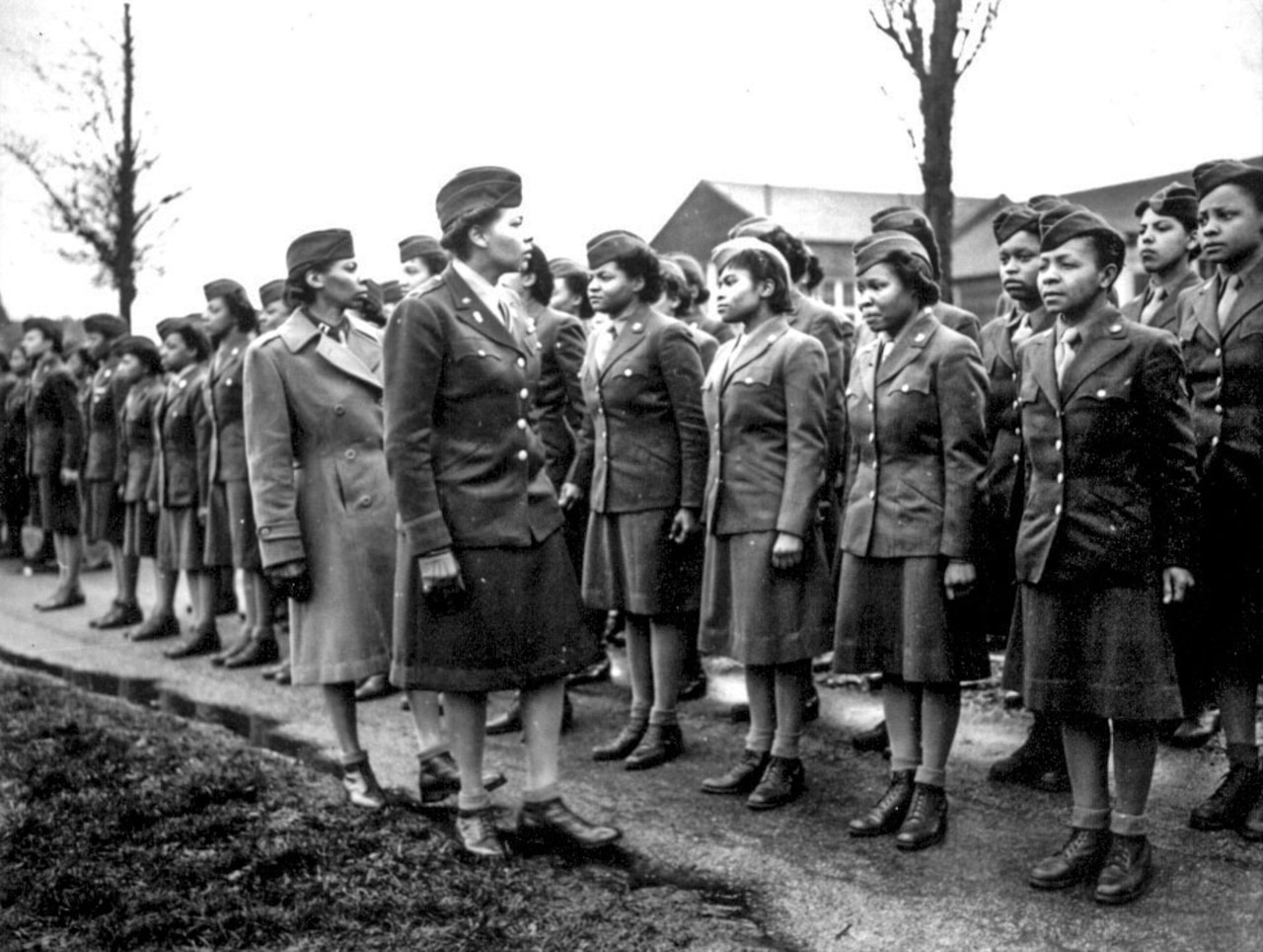 Women's Army Corps Maj. Charity Adams, 6888th Central Postal Directory Battalion commander, and Army Capt. Abbie Noel Campbell, 6888th CPD executive officer, inspect the first soldiers from the unit to arrive in England, Feb. 15, 1945. The only all-African-American Women's Army Corps unit sent to Europe during World War II, the 6888th was responsible for clearing years' worth of backlogged mail in both England and France. National Archives photo
