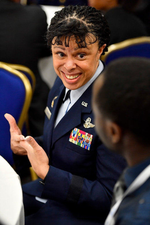 Lt. Gen. Stayce Harris, the Air Force assistant vice chief of staff, mentors high school students during the Black Engineer of the Year Awards Science, Technology, Engineering and Mathematics Conferences' Stars and Stripes ceremony Feb. 10, 2017, in Washington, D.C. (U.S. Air Force photo/Scott M. Ash)