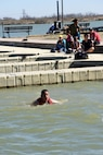 U.S. Air Force Lt. Col. Abraham Salomon, 17th Training Support Squadron Commander, swims in Lake Nasworthy during the Polar Bear Party at the Goodfellow Air Force Base Recreation Camp in San Angelo, Texas, Feb. 11, 2017. Even though it was 82 degrees outside, swimmers said the water was chilly. (U.S. Air Force photo by Staff Sgt. Joshua Edwards/Released)
