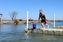 U.S. Air Force Col. Michael Downs, 17th Training Wing Commander, jumps into Lake Nasworthy during the Polar Bear Party at the Goodfellow Air Force Base Recreation Camp in San Angelo, Texas, Feb. 11, 2017. Before taking the plunge, Downs also participated in the 5K run for the same event. (U.S. Air Force photo by Staff Sgt. Joshua Edwards/Released)