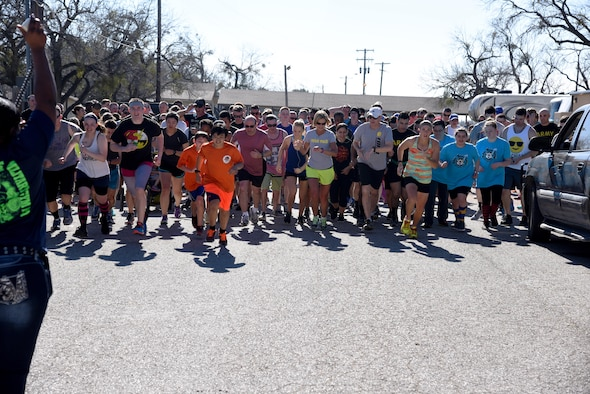 Runners begin the Polar Bear Party 5K at the Goodfellow Air Force Base Recreation Camp in San Angelo, Texas, Feb. 11, 2017. Nearly 250 people showed up for the run and swam in Lake Nasworthy. (U.S. Air Force photo by Staff Sgt. Joshua Edwards/Released)