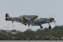 Two P-51 Mustangs take off during the 2017 Heritage Flight Training and Certification Course at Davis-Monthan Air Force Base, Ariz., Feb. 12, 2017. During the course, aircrews practice ground and flight training to enable civilian pilots of historic military aircraft and U.S. Air Force pilots of current fighter aircraft to fly safely in formations together. (U.S. Air Force photo by Senior Airman Chris Drzazgowski)