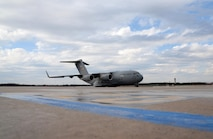 A U.S. Air Force C-17 Globemaster III from Joint Base McGuire-Dix-Lakehurst, N.J. prepares for takeoff while parked on the ramp at the New Jersey Air National Guard's 177th Fighter Wing at the Atlantic City Air National Guard base, N.J. on Jan. 26, 2017. The military transport was for 177th Fighter Wing and 119th Fighter Squadron Advance Echelon (ADVON) personnel and equipment deploying to Osan Air Base, Republic of Korea, in support of the U.S. Pacific Command Theater.