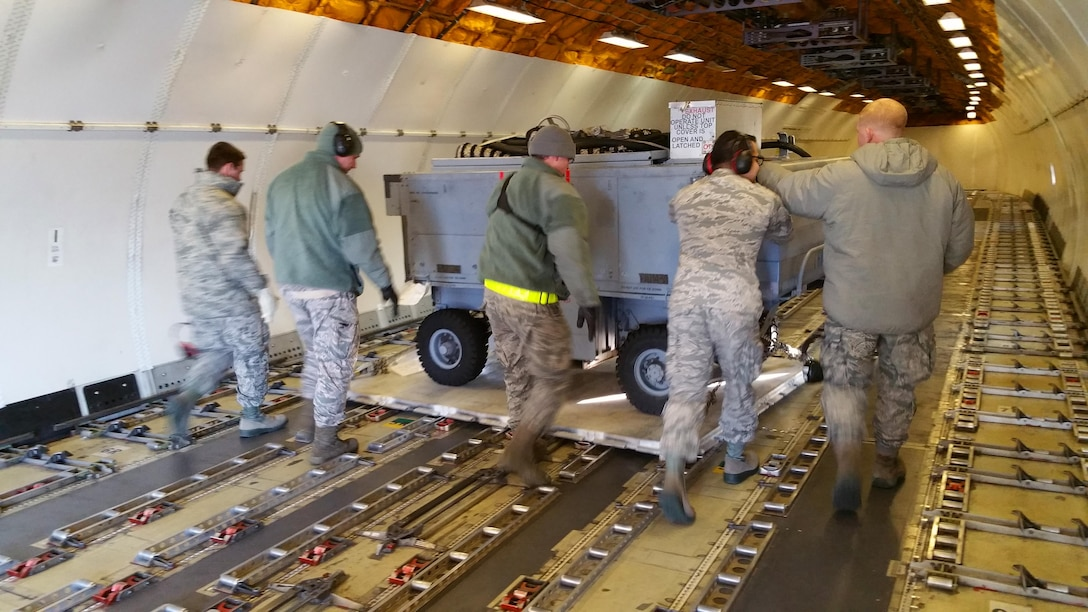 Air National Guard unit members from the 177th Fighter Wing help position pallets of maintenance and support equipment onto a Federal Express MD-11 aircraft at Joint Base McGuire-Dix-Lakehurst, N.J. on Jan. 29, 2017, bound for Osan Air Base, Republic of Korea. Approximately 200 personnel and 12 F-16s are being deployed in support of the U.S. Pacific Command Theater Security Package.  (U.S. Air National Guard photo by Master Sgt. Andrew J. Moseley/Released)
