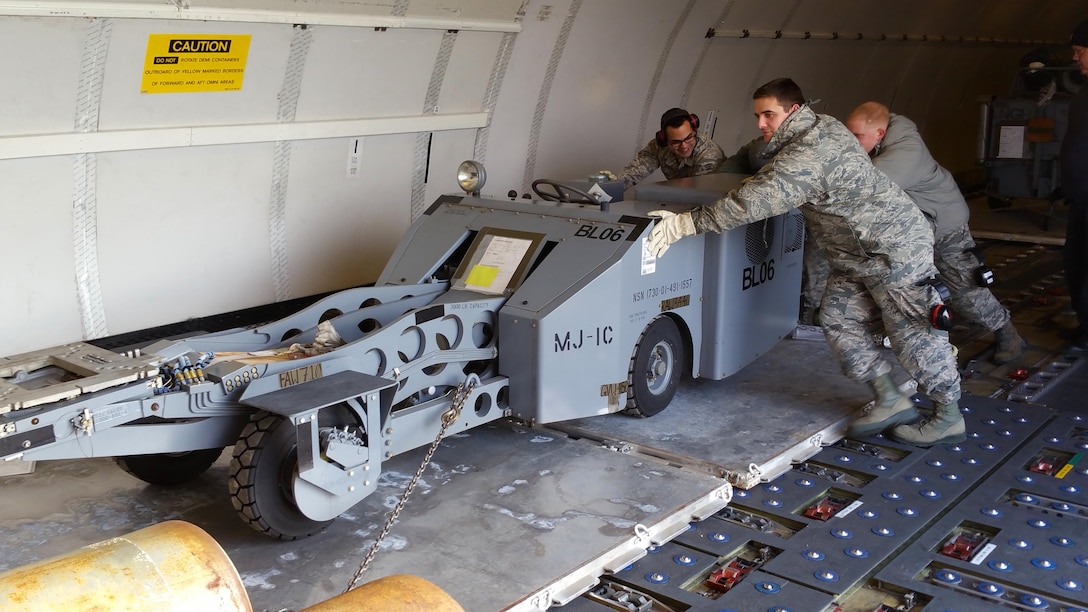 U.S. Air National Guard unit members from the 177th Fighter Wing Legal Office, Communications Flight, Civil Engineer Squadron and Logistics Readiness Squadron volunteered to help position pallets of maintenance and support equipment onto a Federal Express MD-11 aircraft at Joint Base McGuire-Dix-Lakehurst, N.J. on Jan. 29, 2017, bound for Osan Air Base, Republic of Korea. Approximately 200 personnel and 12 F-16s are being deployed in support of the U.S. Pacific Command Theater Security Package.  (U.S. Air National Guard photo by Master Sgt. Andrew J. Moseley/Released)
