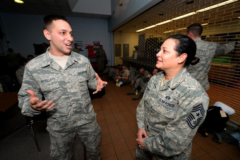 U.S. Air Force Senior Airman Victor Petrilli, New Jersey National Guardsman with the 177th Fighter Wing Medical Group, speaks to the New Jersey National Guard State Command Chief Master Sgt. Janeen Fillari prior to boarding an aircraft, bound for Osan Air Base, Republic of Korea, in support of the U.S. Pacific Command Theater Security Package on Feb. 2, 2017.  (U.S. Air National Guard photo by Master Sgt. Andrew J. Moseley/Released)