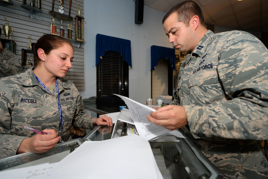 U.S. Air Force Capt. John Dwyer, 177th Fighter Wing Force Support Squadron Commander, and Tech. Sgt. Nicole Piccolo, with the Personnel Deployment Function at the Atlantic City Air National Guard Base, N.J., review the passenger manifest of New Jersey Air National Guard unit members deploying to Osan Air Base, Republic of Korea, in support of the U.S. Pacific Command Theater Security Package on Feb. 2, 2017 (U.S. Air National Guard photo by Master Sgt. Andrew J. Moseley/Released)