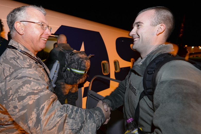 U.S. Air Force Lt. Col. John Fogarty, left, Logistics Readiness Squadron Commander with the New Jersey Air National Guard's 177th Fighter Wing, shakes the hands of Airmen who are boarding a commercial aircraft on the ramp at the Atlantic City Air National Guard Base, N.J. on Feb. 2, 2017, bound for Osan Air Base, Republic of Korea, in support of the U.S. Pacific Command Theater Security Package. (U.S. Air National Guard photo by Master Sgt. Andrew J. Moseley/Released)