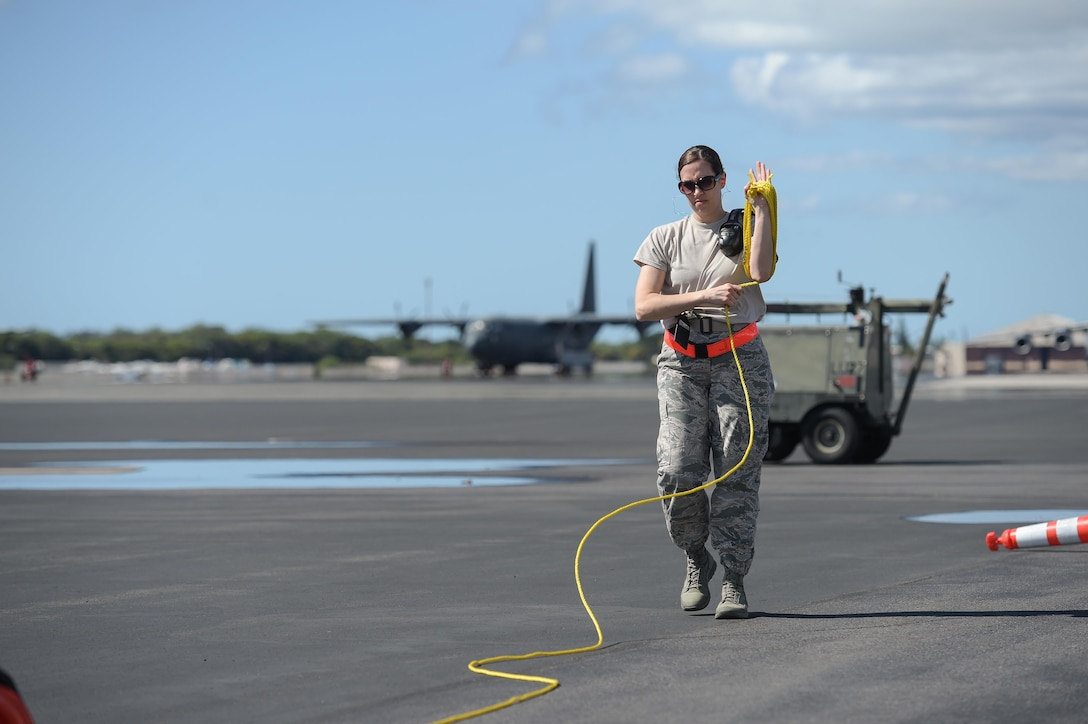 Master Sgt. Angela Leddy, a first sergeant assigned to the 513th Maintenance Squadron, rolls up rope on the flight line Jan. 25 at Joint Base Pearl Harbor-Hickam, Hawaii. Reservists from the 513th Air Control Group deployed to the Hawaiian Islands to provide command and control for Sentry Aloha 17-01, a primarily Reserve and Air National Guard exercise that involves more than 40 aircraft and 1,000 personnel. (U.S. Air Force photo by 2nd Lt. Caleb Wanzer)