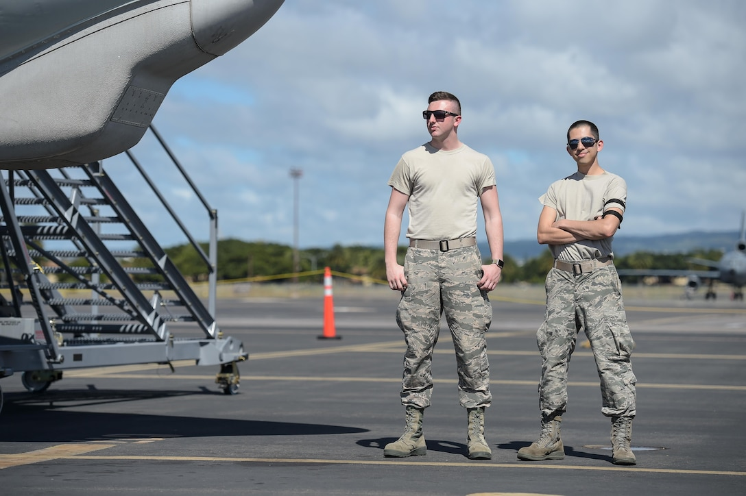 Airman 1st Class Kobe Kiesel (left) and Staff Sgt. Walter Bolles (right), aircrew flight equipment specialists assigned to the 513th Operations Support Squadron, wait for an E-3 Sentry aircraft to land on Jan. 25 at Joint Base Pearl Harbor-Hickam, Hawaii. Reservists from the 513th Air Control Group deployed to the Hawaiian Islands to provide command and control for Sentry Aloha 17-01, a primarily Reserve and Air National Guard exercise that involves more than 40 aircraft and 1,000 personnel. (U.S. Air Force photo by 2nd Lt. Caleb Wanzer)