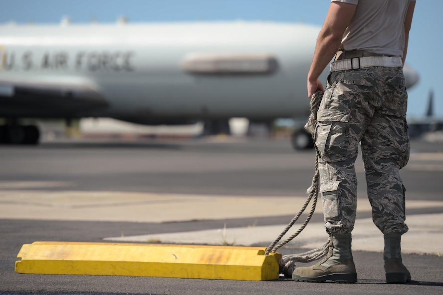 An Airman assigned to the 513th Aircraft Maintenance Squadron waits for an E-3 Sentry Airborne Warning and Control System aircraft to taxi into place Jan. 25 after returning from a mission at Joint Base Pearl Harbor-Hickam, Hawaii. Reservists from the 513th Air Control Group deployed to the Hawaiian Islands to provide command and control for Sentry Aloha 17-01, a primarily Reserve and Air National Guard exercise that involves more than 40 aircraft and 1,000 personnel. (U.S. Air Force photo by 2nd Lt. Caleb Wanzer)