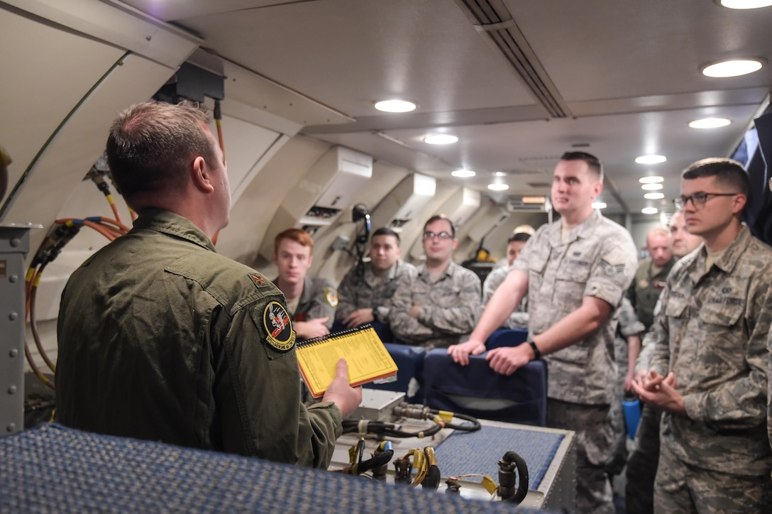 Maj. Matthew Heckman, an air battle manager assigned to the 970th Airborne Air Control Squadron, briefs Airmen assigned to Joint Base Pearl Harbor-Hickam, Hawaii, on Jan. 31 before a mission in support of Sentry Aloha. Reservists from the 513th Air Control Group deployed to the Hawaiian Islands to provide command and control for Sentry Aloha 17-01, a primarily Reserve and Air National Guard exercise that involves more than 40 aircraft and 1,000 personnel. (U.S. Air Force photo by 2nd Lt. Caleb Wanzer)