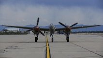 A P-38 lightning taxies on the flight line during the 2017 Heritage Flight Training and Certification Course at Davis-Monthan Air Force Base, Ariz., Feb. 12, 2017. The HFTCC provides civilian and military pilots the opportunity to practice flying in formation together in preparation for future air shows. (U.S. Air Force Photo by Airman 1st Class Nathan H. Barbour)