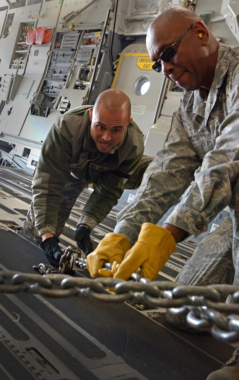 Senior Airman Frank Dalao and Master Sgt. Vantory Miles, 55th Aeroport Squadron air transportation specialists, chain down a Humvee in a C-17 Globemaster III prior to its take off from Travis Air Force Base, Calif., for Patriot Wyvern on Feb. 11, 2017. Patriot Wyvern is a hands-on, bi-annual event conducted by the 349th Air Mobility Wing designed to hone combat skills and improve organizational interoperability. (U.S. Air Force photo/Staff Sgt. Daniel Phelps)