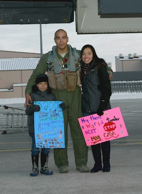 Capt. Sam, a pilot assigned to the 34th Expeditionary Bomb Squadron, reunites with his wife, Cindy, and his son, Mateo, at Ellsworth Air Force Base, S.D., Feb. 8, 2017. Ellsworth Airmen conducted integrated bomber training missions in the maritime domain demonstrating our commitment to deterrence, offering assurance to our allies, and strengthening regional security and stability in the Indo-Asia-Pacific region. (U.S. Air Force photo by Airman 1st Class Donald C. Knechtel)