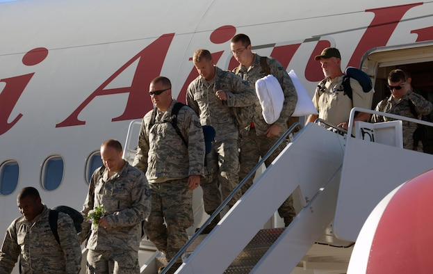Airmen returning from their deployment step off the plane and are welcomed home at Ellsworth Air Force Base, S.D., Feb. 12, 2017. Ellsworth Airmen conducted integrated bomber training and missions in the maritime domain demonstrating our commitment to deterrence, offering assurance to our allies, and strengthening regional security and stability in the Indo-Asia-Pacific region. (U.S. Air Force photo by Airman 1st Class Donald C. Knechtel)