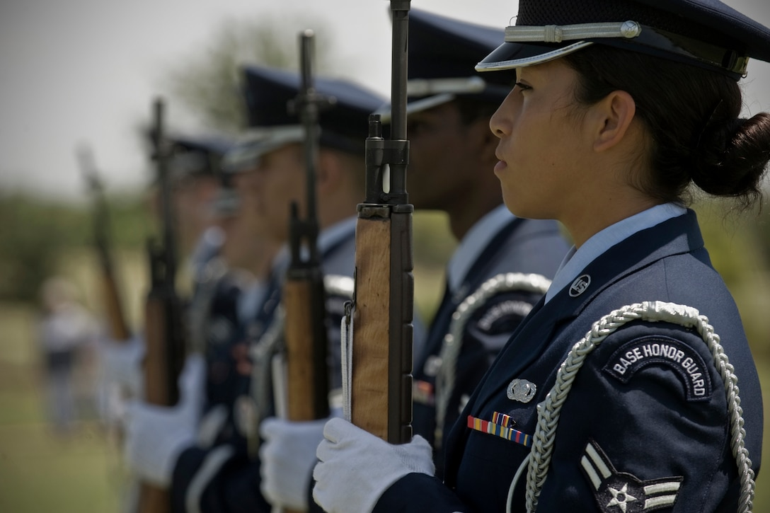 Air Force Airman 1st Class Twila Stone readies her weapon during a ceremony