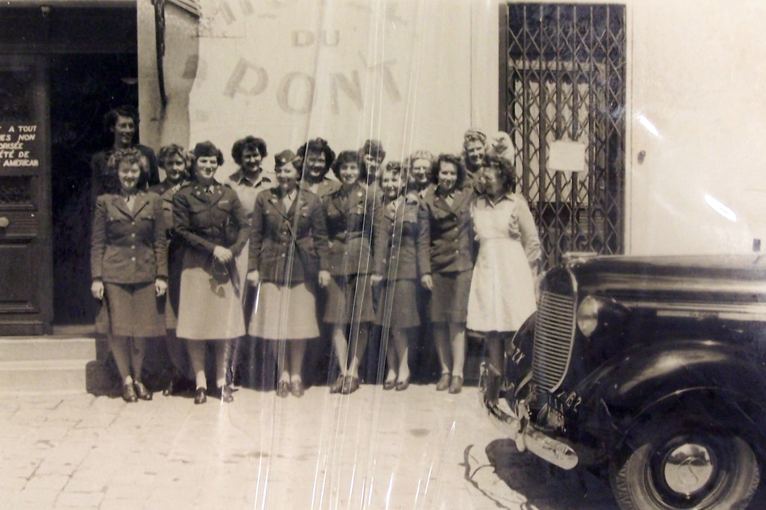 Army Capt. Smitty McClellan poses with a group of the Women's Army Corps unit she led during World War II