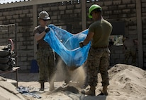 U.S. Marine Corps Cpl. Mario Rojas, with Marine Wing Support Squadron 172, and U.S. Navy Constructionman Elijah Farladansky-Doyle, a steel worker with Naval Mobile Construction Battalion 5, assist in the construction of a classroom at Ban Kok Kee San Toor, Khon Kaen Province, Thailand during the 36th iteration of exercise Cobra Gold, on Feb. 11, 2017.  Similar to last year, Cobra Gold 17 emphasizes coordination on civic action, such as humanitarian assistance and disaster relief, seeking to expand regional cooperation and collaboration in these vital areas.  (U.S. Marine Corps photo by Staff Sgt. Nathan O. Sotelo)