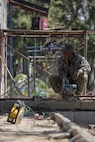 A Royal Thai Air Force airman cuts a steel beam at Ban Kok Kee San Toor, Khon Kaen Province, Thailand during the 36th iteration of exercise Cobra Gold, on Feb. 11, 2017.  Similar to last year, Cobra Gold 17 emphasizes coordination on civic action, such as humanitarian assistance and disaster relief, seeking to expand regional cooperation and collaboration in these vital areas.  (U.S. Marine Corps photo by Staff Sgt. Nathan O. Sotelo)