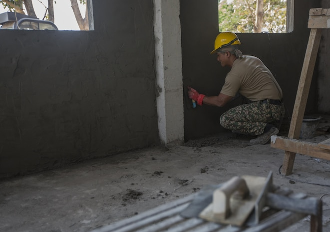 A Malaysian Army soldier builds a wall at Ban Kok Kee San Toor, Khon Kaen Province, Thailand during the 36th iteration of exercise Cobra Gold, on Feb. 11, 2017.  Similar to last year, Cobra Gold 17 emphasizes coordination on civic action, such as humanitarian assistance and disaster relief, seeking to expand regional cooperation and collaboration in these vital areas.  (U.S. Marine Corps photo by Staff Sgt. Nathan O. Sotelo)