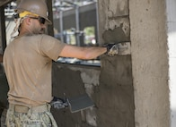 U.S. Navy Petty Officer 3rd Class Ryan McCullough, a builder with Naval Mobile Construction Battalion 5, assists in the construction of a classroom at Ban Kok Kee San Toor, Khon Kaen Province, Thailand during the 36th iteration of exercise Cobra Gold, on Feb. 11, 2017.  Similar to last year, Cobra Gold 17 emphasizes coordination on civic action, such as humanitarian assistance and disaster relief, seeking to expand regional cooperation and collaboration in these vital areas.  (U.S. Marine Corps photo by Staff Sgt. Nathan O. Sotelo)