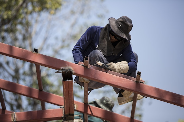 A Royal Thai Air Force airman welds at Ban Kok Kee San Toor, Khon Kaen Province, Thailand during the 36th iteration of exercise Cobra Gold, on Feb. 11, 2017.  Similar to last year, Cobra Gold 17 emphasizes coordination on civic action, such as humanitarian assistance and disaster relief, seeking to expand regional cooperation and collaboration in these vital areas.  (U.S. Marine Corps photo by Staff Sgt. Nathan O. Sotelo)
