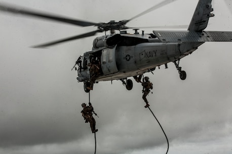 Marines with the Maritime Raid Force, 31st Marine Expeditionary Unit, fast rope from a UH-1Y Huey, during a fast rope training event at Anderson Air Force Base, Guam, Jan. 10, 2017. As the Marine Corps' only continuously forward-deployed unit, the 31st Marine Expeditionary Unit's air-ground-logistics team provides a flexible force, ready to perform a wide range of military operations, from limited combat to humanitarian assistance operations, throughout the Indo-Asia-Pacific region. (U.S. Marine Corps photo by Lance Cpl. Jorge A. Rosales/ Released)