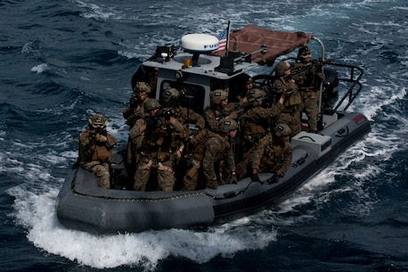 Marines with the Maritime Raid Force, 31st Marine Expeditionary Unit, provide security on a rigid-hulled inflatable boat during a visit, board, search, seizure, training exercise at Apra Harbor, Guam, Jan. 13, 2017. As the Marine Corps' only continuously forward-deployed unit, the 31st Marine Expeditionary Unit's air-ground-logistics team provides a flexible force, ready to perform a wide range of military operations, from limited combat to humanitarian assistance operations, throughout the Indo-Asia-Pacific region. (U.S. Marine Corps photo by Lance Cpl. Jorge A. Rosales/ Released)