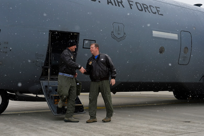 Lt. Col. Barry A. King. II, 37th Airlift Squadron commander, left, shakes hands with Chief Master Sgt. Samuel Frederick, 37th AS superintendent, as he disembarks a C-130J Super Hercules on Ramstein Air Base, Germany, Feb. 10, 2017. The 37th AS celebrated its 75th Anniversary with a training mission which culminated with a flight over the squadron building. (U.S. Air Force photo by Airman 1st Class Joshua Magbanua)