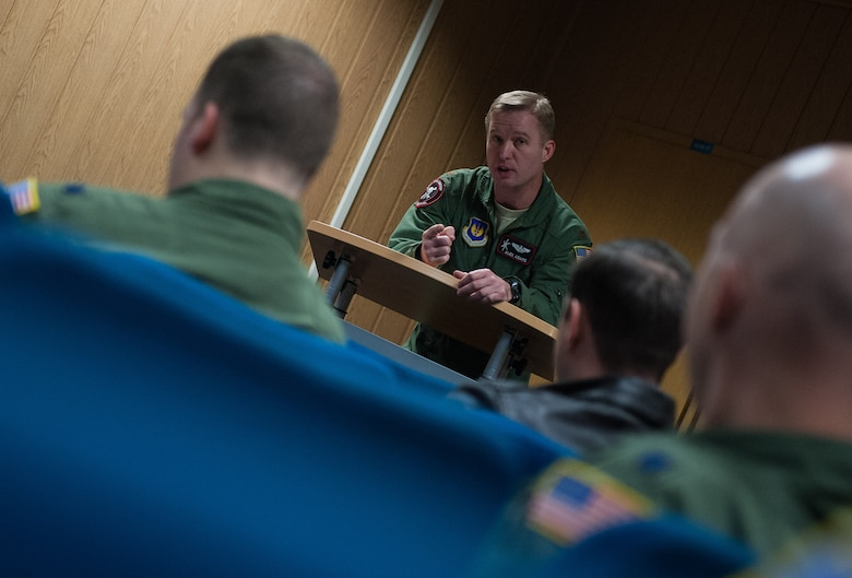 Maj. Alex Adams, 37th Airlift Squadron/86th Operations Group flight chief, briefs a group of pilots about to take to the skies during the 37th AS's 75th anniversary on Ramstein Air Base, Germany, Feb. 10, 2017. Activated in February 1942, the 37th AS was founded under the First Air Force at Patterson Field, Ohio. The unit trained in the southeastern U.S. before participating in its first assignment in Egypt of November 1942 as part of President Franklin D. Roosevelt's decision to aid the Royal Air Force Western Desert Air Force during World War II. (U.S. Air Force photo by Senior Airman Lane T. Plummer)