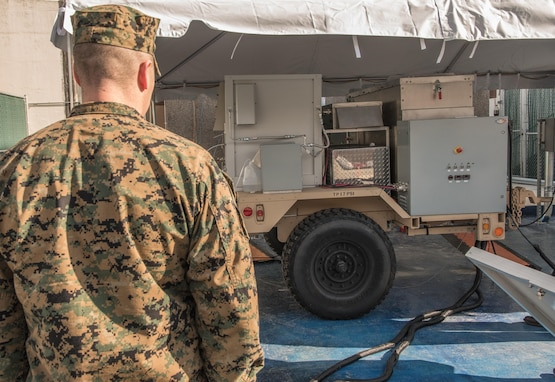 Lt. Col. William P. Dobbins, an engineer for U.S. Marine Corps Forces Command, watches a demonstration and test kickoff of the first logistics fuel (JP-8) compatible renewable-hybrid Solid Oxide Fuel Cell (SOFC) system Jan. 26, 2017, at Naval Surface Warfare Center, Carderock Division in West Bethesda, Md. (U.S. Navy photo by Jake Cirksena/Released)