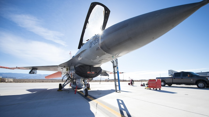 A QF-16 drone sits on the flightline before its first flight at Holloman Air Force Base, N.M., Feb. 10, 2017. Lt. Col. Ronald King, the 82nd Aerial Targets Squadron, Det. 1 commander, piloted the drone during the first flight since the 82nd ATRS, Det. 1 transitioned from QF-4 Phantoms to QF-16s. The QF-16 serves as a full-scale aerial target to test next-generation weapons systems. (U.S. Air Force photo by Senior Airman Emily Kenney)