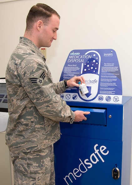 Senior Airman Matthew Marra, 66th Medical Squadron pharmacy technician, discards medication in a MedSafe container in the lobby of the clinic last month. Personnel with base access may now safely turn in unused or expired medication at the MedSafe drop box Monday through Friday from 7:30 a.m. to 4:30 p.m. (U.S. Air Force photo by Mark Herlihy)