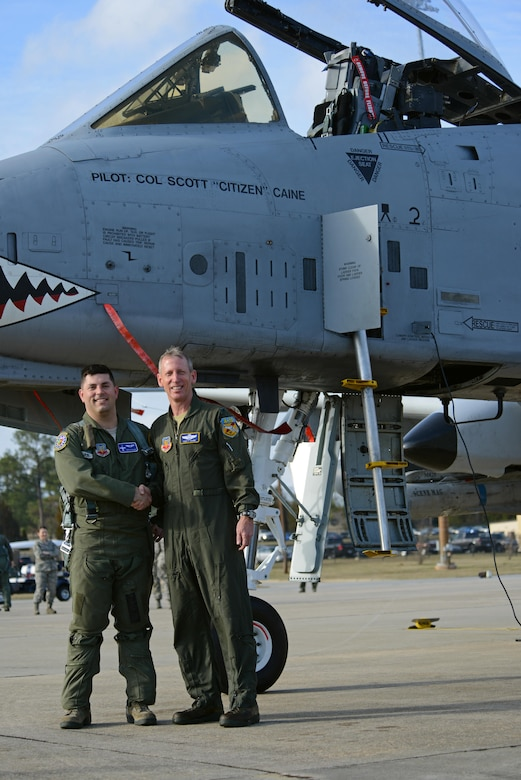 U.S. Air Force Capt. Eric Calvey (left), 74th Fighter Squadron A-10 instructor and chief of weapons, and Col. Scott Caine (right), 9th Air Force vice commander, stand in front of an A-10C Thunderbolt II following Caine's final flight in the Air Force, Shaw Air Force Base, S.C., Feb. 8, 2017. Calvey acted as a wingman during Caine's final flight that marked the end of the vice commander's 30 years of service. (U.S. Air Force photo by Airman 1st Class Kathryn R.C. Reaves)
