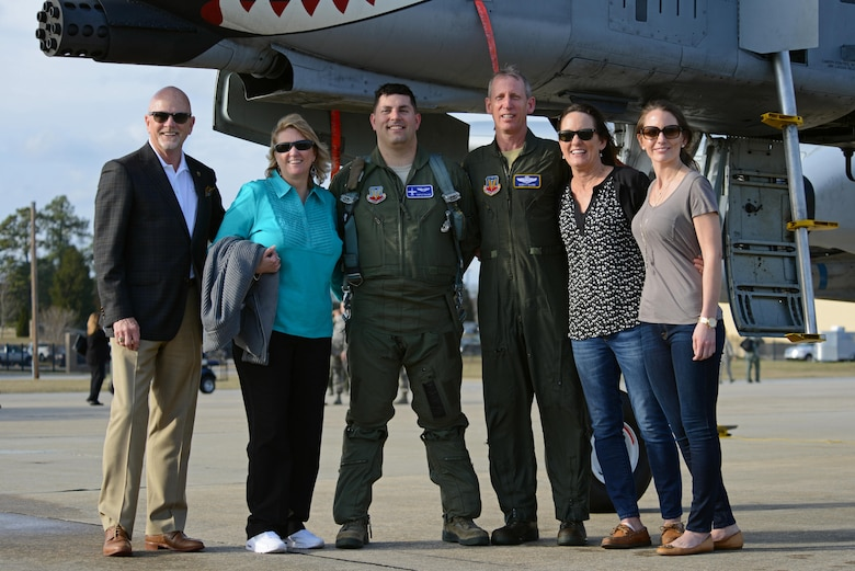 U.S. Air Force Col. Scott Caine, 9th Air Force vice commander, stands with family and friends following the final flight of his Air Force career, Shaw Air Force Base, S.C., Feb. 8, 2017. Family, friends and coworkers greeted Caine after he landed and participated in final flight traditions, such as hosing Caine with water. (U.S. Air Force photo by Airman 1st Class Kathryn R.C. Reaves)