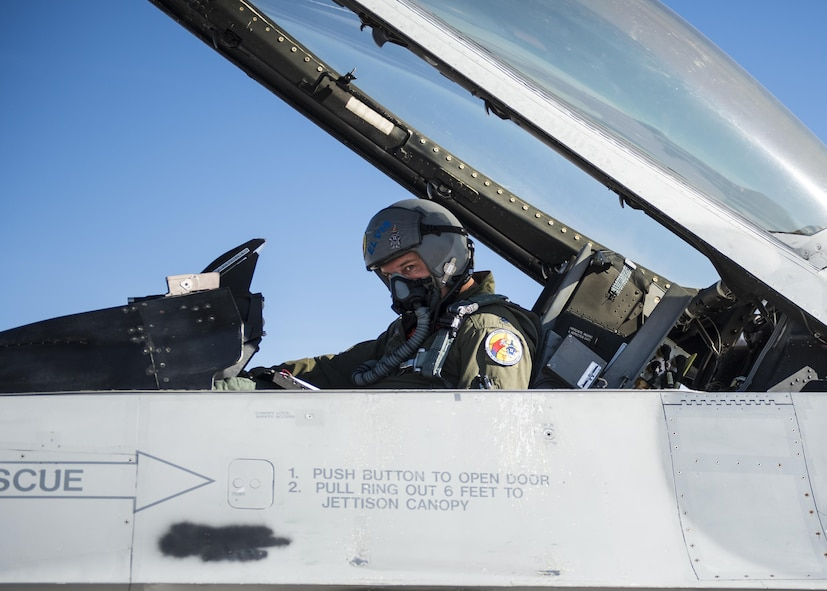 Lt. Col. Ronald King, the 82nd Aerial Targets Squadron, Det. 1 commander, prepares for the first QF-16 drone flight at Holloman Air Force Base, N.M., on Feb. 10, 2017. The QF-16 has been flying at Tyndall Air Force Base, Florida since late 2012. This was the first flight at Holloman since the QF-4 Phantom officially retired in 2016 and the detachment transitioned to flying QF-16s. (U.S. Air Force photo by Senior Airman Emily Kenney)