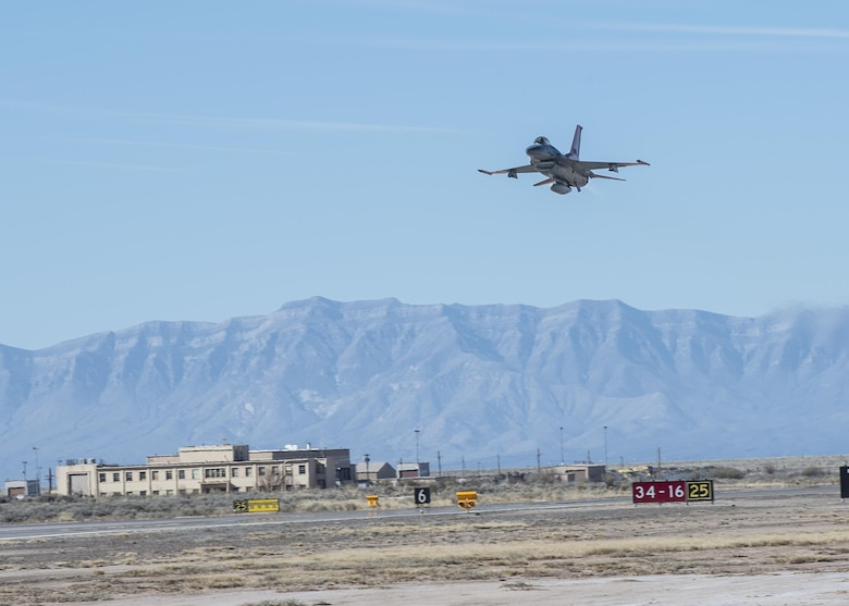 A QF-16 drone flies over Holloman Air Force Base, N.M., on Feb. 10, 2017. Lt. Col. Ronald King, the 82nd Aerial Targets Squadron, Det. 1 commander, piloted the drone during the first flight at Holloman since the transition from QF-4 Phantoms to QF-16s. The QF-16 serves as a full-scale aerial target to test next-generation weapons systems. (U.S. Air Force photo by Senior Airman Emily Kenney)