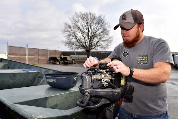 Nathan Koppersmith, 19th Force Support Squadron Outdoor Recreation specialist, checks a boat engine before offering it as a rental to a customer at Outdoor Recreation, Feb. 7, 2016 on Little Rock Air Force Base, Ark. Outdoor Recreation offers a multitude of equipment to suit Airman and their families needs.