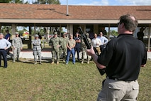 USCENTCOM and USSOCOM hosted a familiarization fire (FAMFIRE) demonstration of non-lethal weapons. During the event, attendees had the opportunity to use some of the weapons and fire them in a controlled environment.