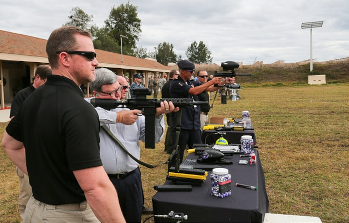 USCENTCOM and USSOCOM hosted a familiarization fire (FAMFIRE) demonstration of non-lethal weapons. During the event, attendees had the opportunity to use some of the weapons and fire them in a controlled environment. Here a variety of pepperball and paintball non-lethal munitions are fired.