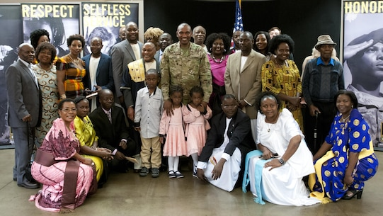 Maj. Frank Musisi, center, celebrates his promotion from captain to major with family and friends Oct. 14, 2016, at Joint Forces Training Base Los Alamitos, Calif..