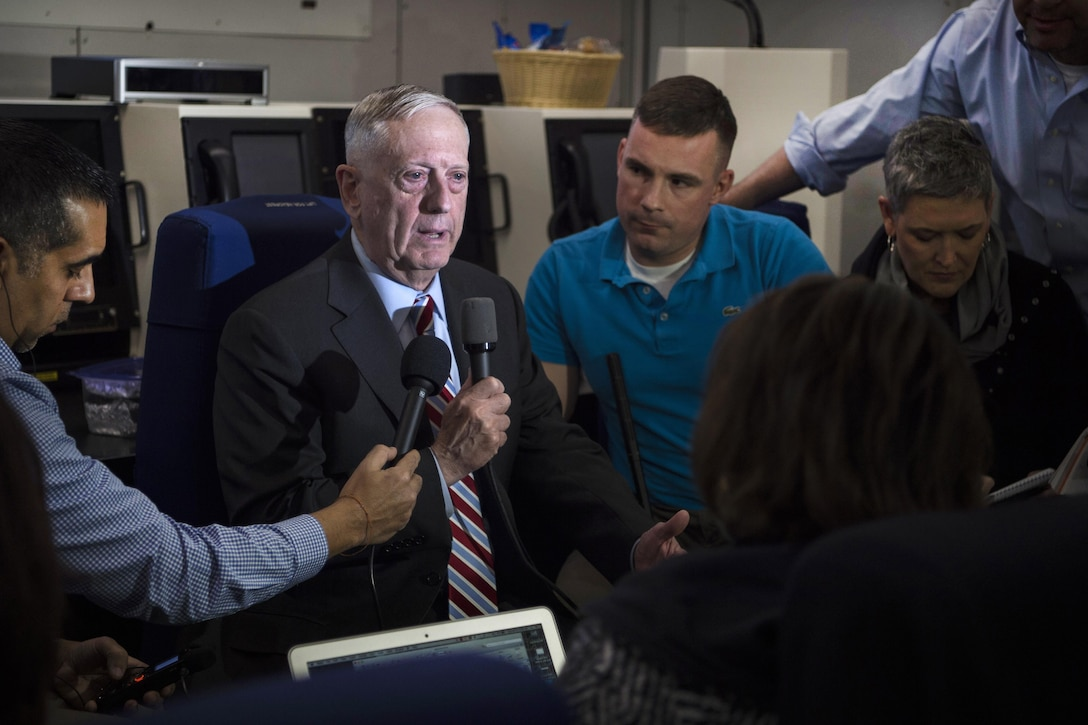 Defense Secretary Jim Mattis, center, briefs reporters while flying over the Atlantic Ocean en route to Brussels for a NATO Defense Ministerial, Feb. 14, 2017. DoD photo by Air Force Tech. Sgt. Brigitte N. Brantley