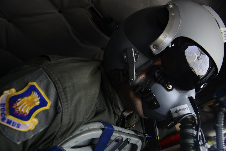 Master Sgt. Bartek Bachleda, 22nd Air Refueling Wing Plans and Programs superintendent, refuels an F-18 Hornet in the air over Missouri, Feb. 10, 2017. Bachleda developed an ergonomically correct support cushion and floor panel for KC-135 Stratotanker boom operators, which potentially saves Airmen from future medical problems. (U.S. Air Force photo/Staff Sgt. Trevor Rhynes)
