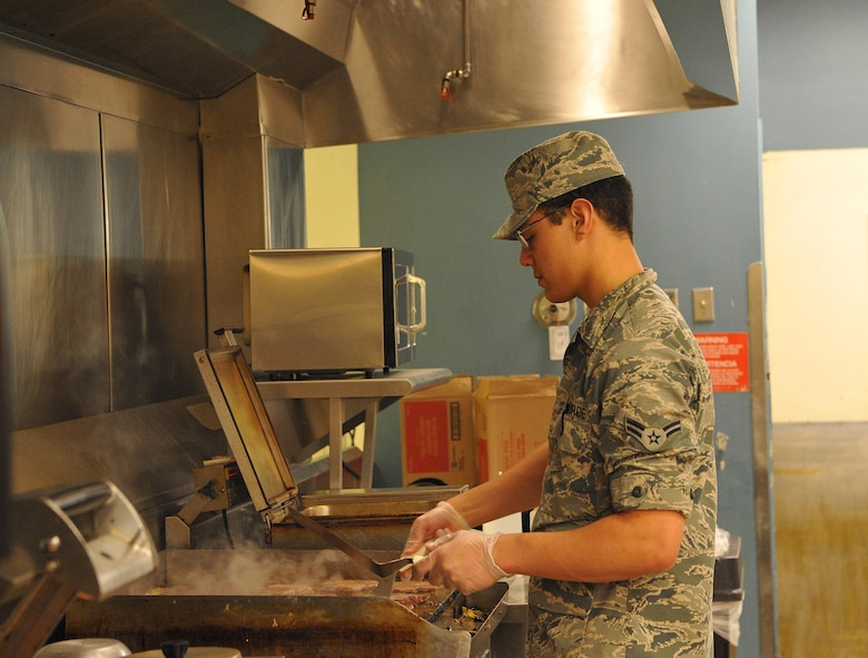 Airman 1st Class Ehiku Nunes-Lopez, 9th Force Support Squadron food service apprentice, makes food for evacuees in response to the Oroville spillway evacuation notice at Beale Air Force Base, California, Feb. 13, 2017. Beale provided evacuees with shelter, food, and water. (U.S. Air Force photo/Airman Tristan D. Viglianco)